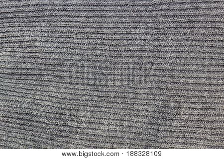 Grey pattern background of knitting wool texture