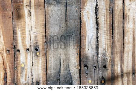 Natural brown wooden background from several rough boards