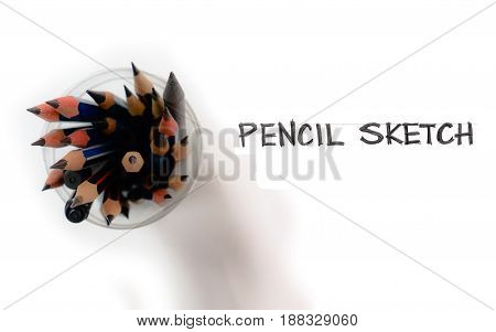 Pencils group isolate and freehand word on white background in clear plastic cut from water bottle Macro photo zoom in and crop.