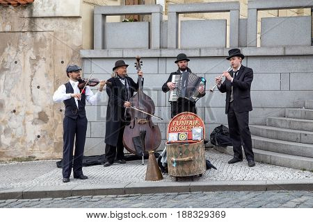Prague, Czech Republic - March 20, 2017: Group of street musicians performings in the city centre