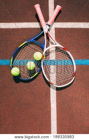 Tennis Balls with two Racket on the racket in tennis court, top view