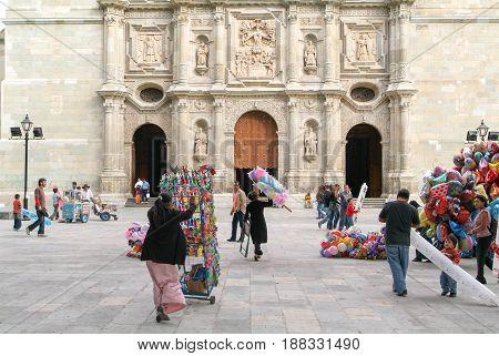 Oaxaca, Mexico - 11 January 2009: People walking in front of Santo Domingo de Guzman church on Oaxaca Mexico