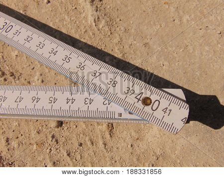 Foldable ruler as measuring instrument at construction