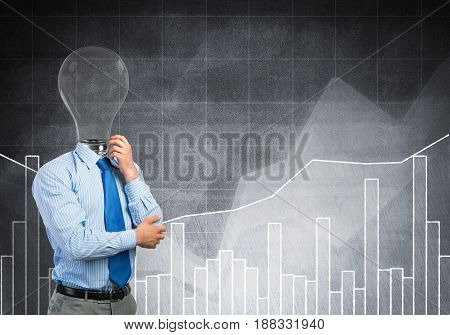 Pensive businessman with lamp head on concrete background