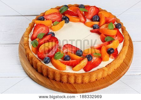 Tart Decorated With Fruit And Berries