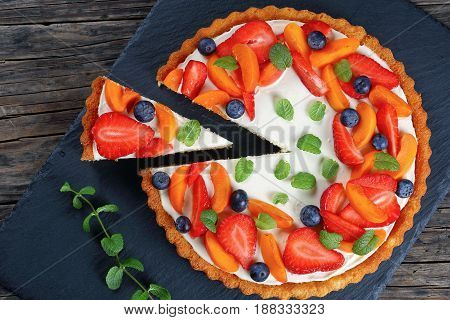 Cake Topped With Strawberries, Apricots, Mint