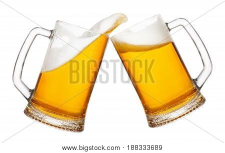cheers, two mugs of beer toasting creating splash isolated on white background. Pair of beer mugs making toast. Beer up. Golden beer splash.