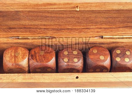Set Of Dice In A Wooden Box Close-up