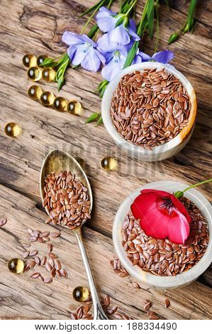 Flax Seeds In Spoons And Bowl