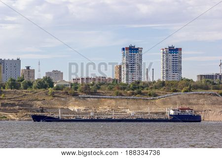 Ship on the river against the backdrop of the city