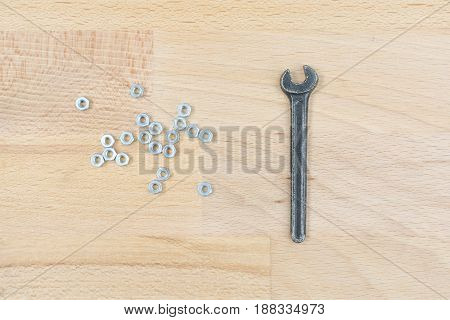 Old Spanner On A Wooden Table