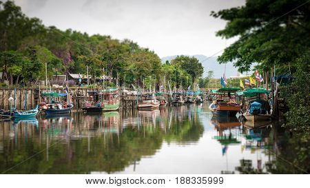 Tilt-shift blur effect. Scenery of fishing boats in canal Phuket Thailand