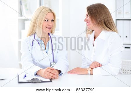 Doctor and patient in hospital. Medicine and health care concept