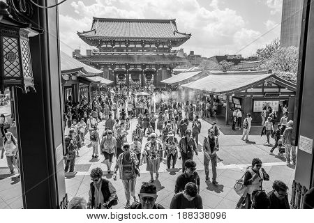 Tokyo, Japan - April 19, 2017: many people at north face of Hozomon Gate of Buddhist Temple Senso-ji, Asakusa, the oldest temple in Tokyo from main hall of Kannon Temple. Black and white pictures.