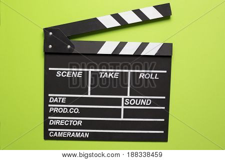 movie clapper on green background top view