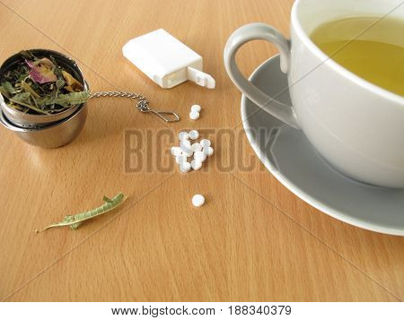Cup of tea with white sweetener tablets