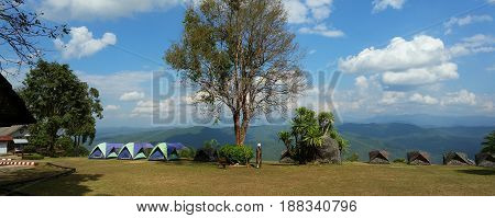 Panoramic photo of the camping on the mountain peak.