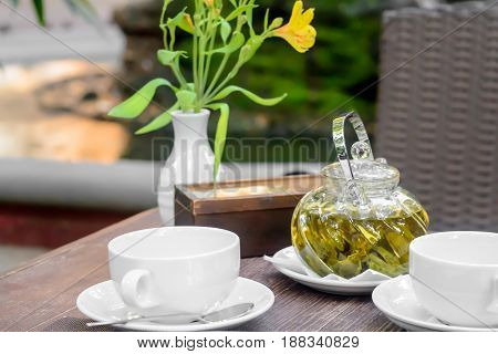 Flower And Hot Tea With Sugar. Transparent Brew Glass On The Table. Relax Concept.