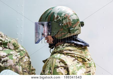 Samara Russia - May 27 2017: Special Forces soldier in protective helmet with glasses and camouflage military uniform