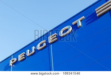 Moscow Russia - May 14 2016: The emblem Peugeot on the office of official dealer. Peugeot is a French car brand part of PSA Peugeot Citroen