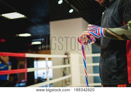 Professional Muay Thai And K1 Fighter. Male Boxer In Training Sportswear, An Exercise In The Sports