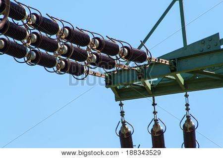 Detail of high-voltage ceramic insulator. High Voltage Lead. Electricity distribution