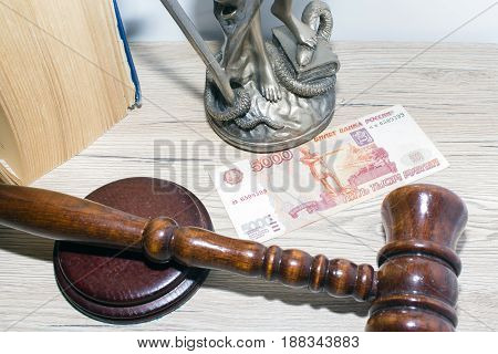 Law and Justice concept. Mallet of the judge book scales of justice. Courtroom theme. Bribery.