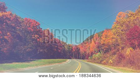 Scenic Road In Autumn With Colorful Foliage