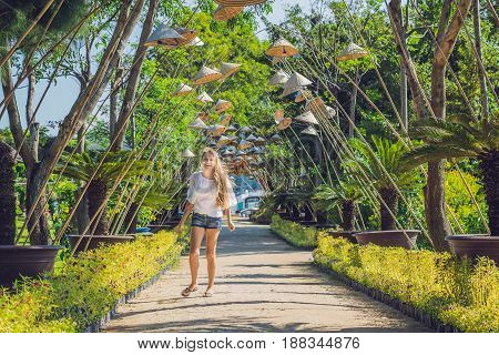 Young Woman Tourist And Vietnamese Hats. Travel Around Vietnam Concept
