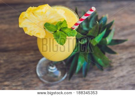 Pineapple And Pineapple Smoothies On An Old Wooden Background