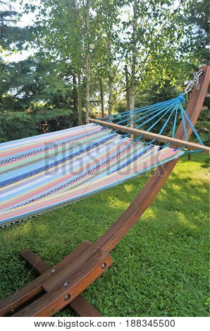 Hammock in the Shade. A colorful garden hammock in the shade