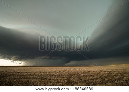 Inflow bands stream into a violent supercell thunderstorm on the high plains of eastern Colorado. poster