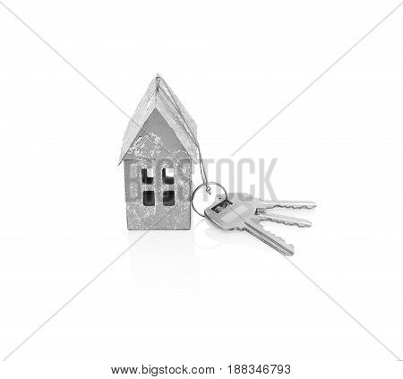 Model of the house with keys isolated on white background.