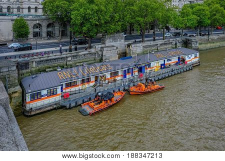 Embankment London England - May 2 2017: RNLI Lifeboat station with lifeboats moored and ready for action.