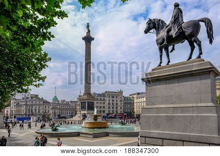 Charing Cross London England - May 11 2017: Trafalgar Square south side with view of Nelson's Column.and fountain.