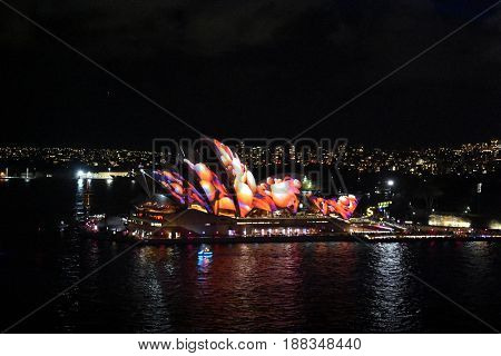 Sydney Australia - May 26 2017. Sydney Opera House illuminated with colourful light design imagery during the Sydney Vivid show. Free annual outdoor event of light music and ideas.