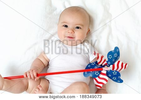 Baby Girl Holding A Pinwheel