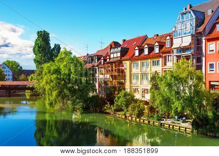 Scenic summer view of the German traditional Old Town architecture and bridge over Pegnitz river in Nuremberg, Bavaria, Germany
