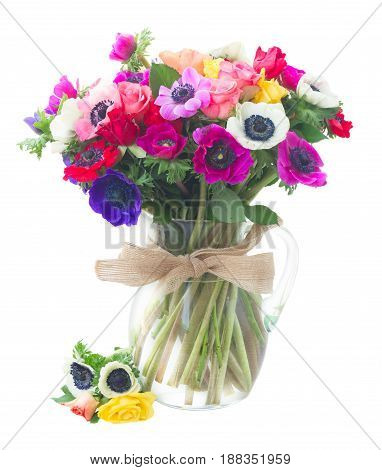 Fresh colorful Anemones and roses flowers bouqet in glass vase isolated on white background