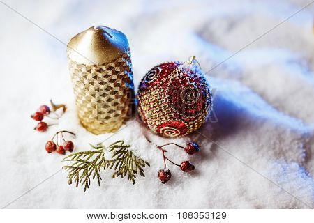Candle and christmas decoration in snow with blue light