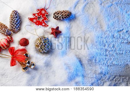 Christmas decorations in snow with blue backlight