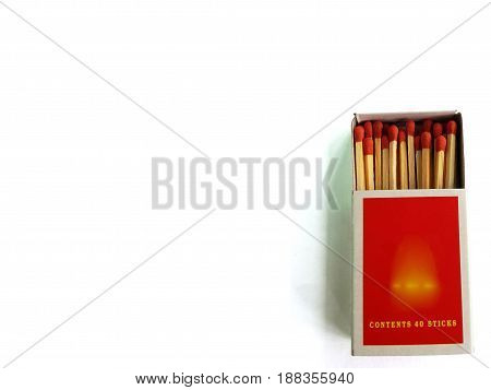 Matches in a matchbox on white background,Open matchbox,Top close-up view.