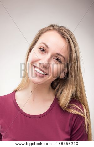 One Young Woman Smiling Candid Headshot