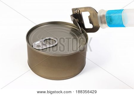 One Can And Can Opener On White Background. One Shiny Food Tin Can With No Label And Can Opener Isol