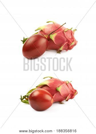 Pile of tropical fruits isolated over the white background