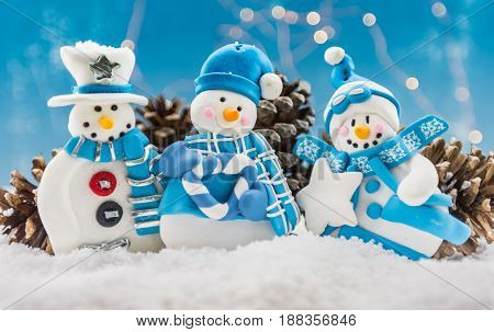 Three Snow Men Ornaments With Snow