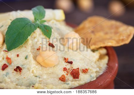 Vegetarian Humus with sesame seeds and tortilla chips.