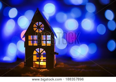 Burning lantern in the snow, christmas background