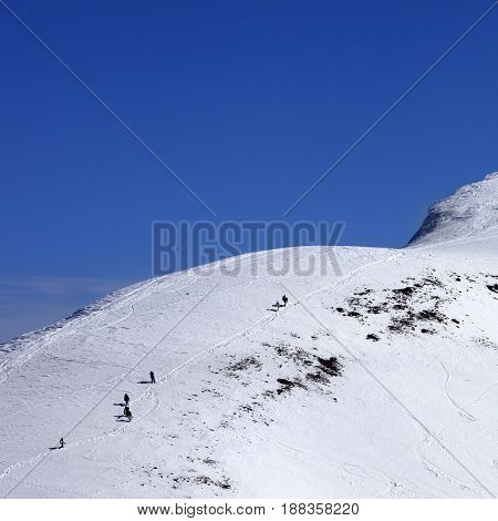 Snowboarders And Skiers Downhill On Off Piste Slope At Sun Day