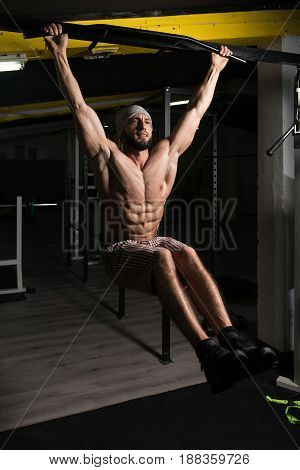Bodybuilder Doing Pull Ups Best Back Exercises